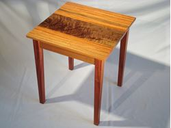 African Ribbon Mahogany and Figured Walnut Table