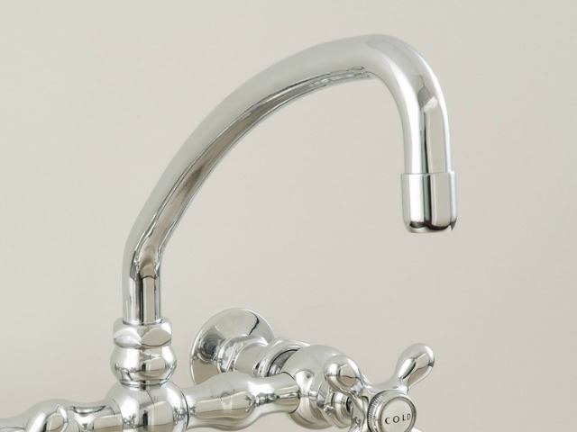 Picture of Strom Plumbing Wall-Mounted Kitchen Faucet with Arched Swivel Spout & X-Point Handles
